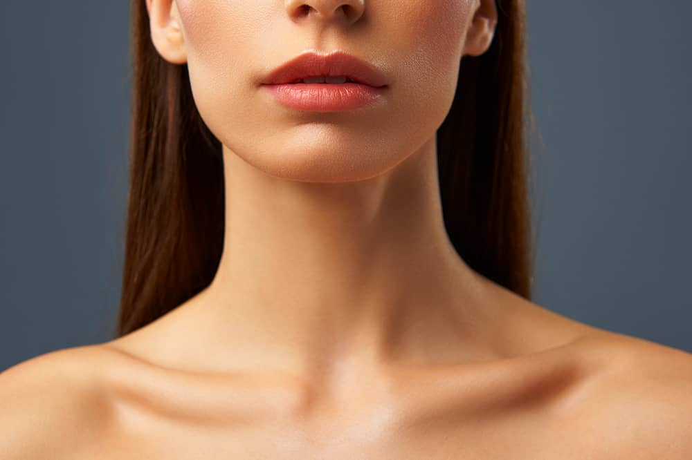 Woman shown from nose down to decolletage