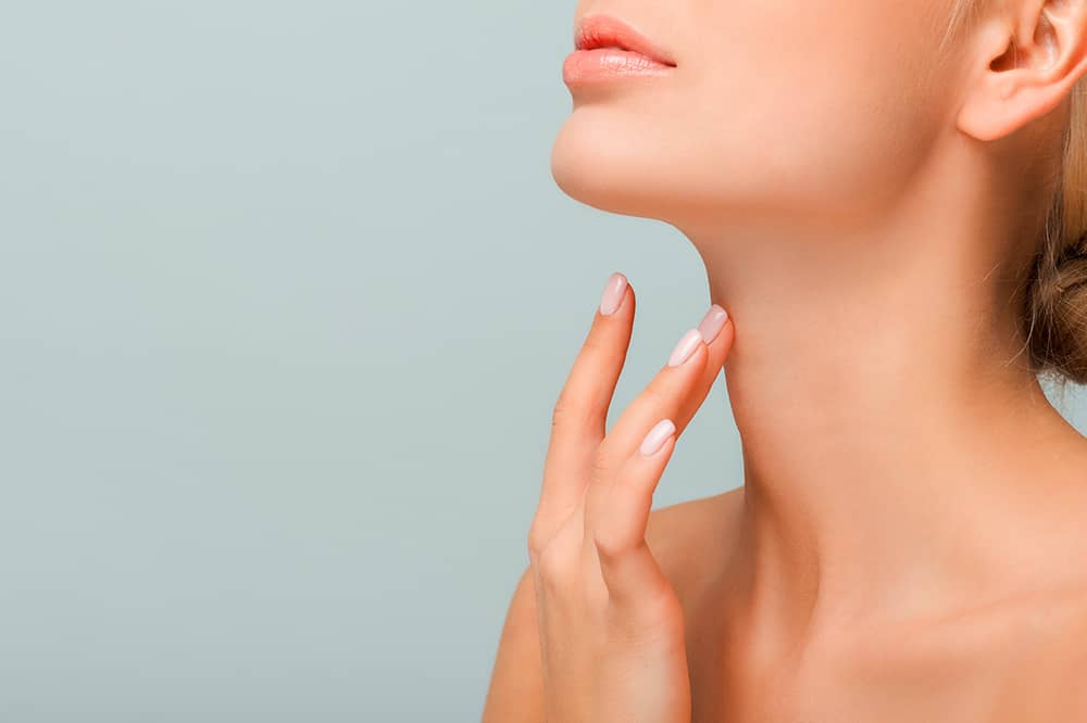 Woman with perfect skin and fingers on neck