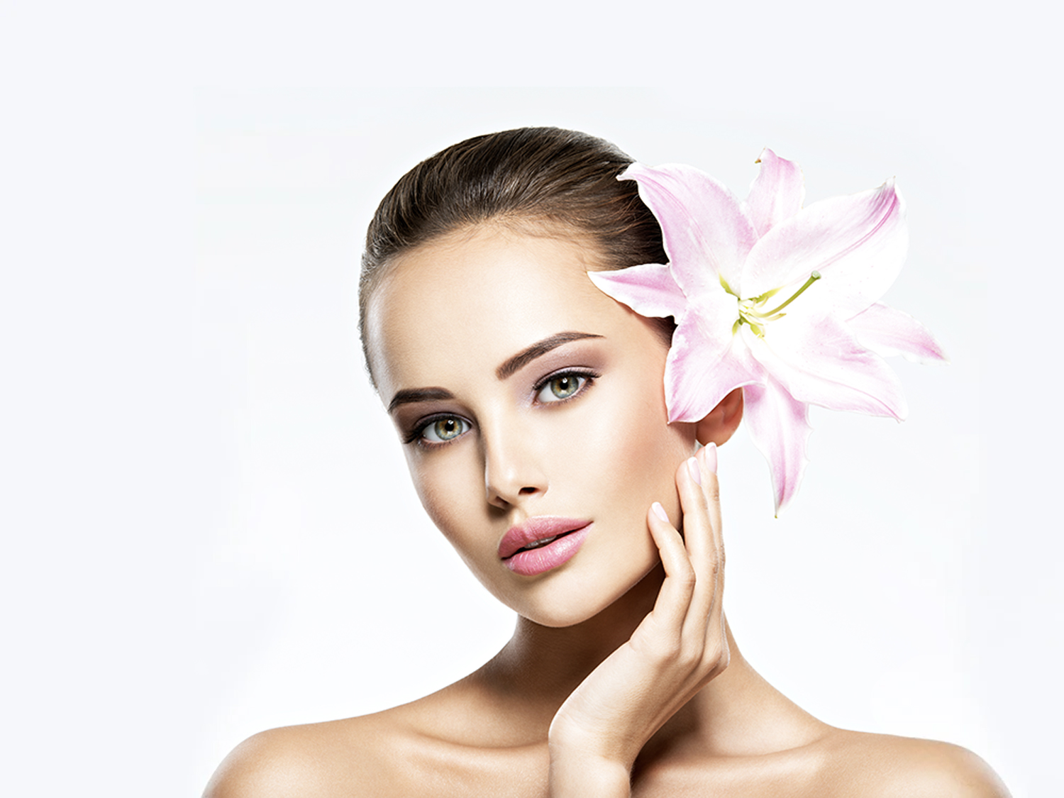Closeup on Beautiful Womans Face with flower in her ear