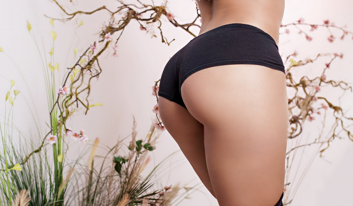Shot of taut buttocks of a woman on a floral background